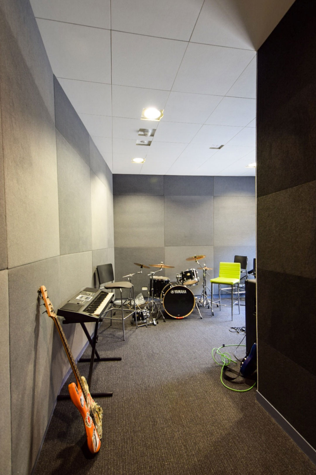 Music room with instruments and acoustic panels